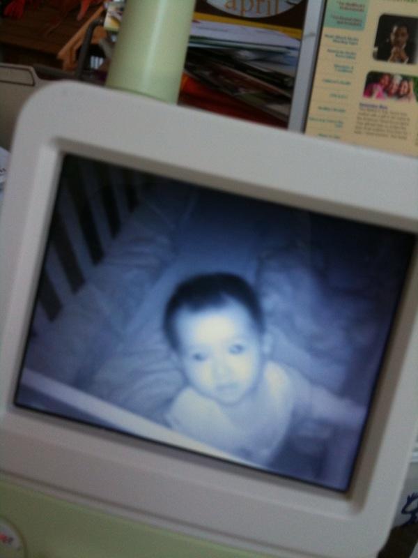 Eva standing in crib